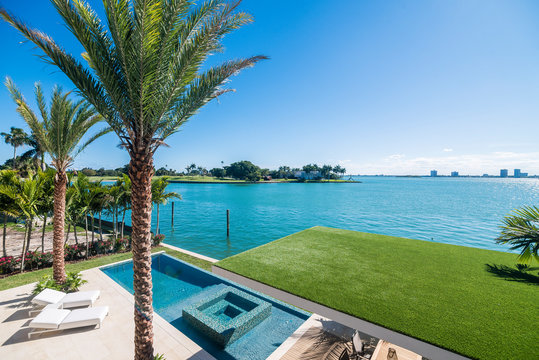 View of a nice pool and waterfront from terrace of a luxury home in Miami