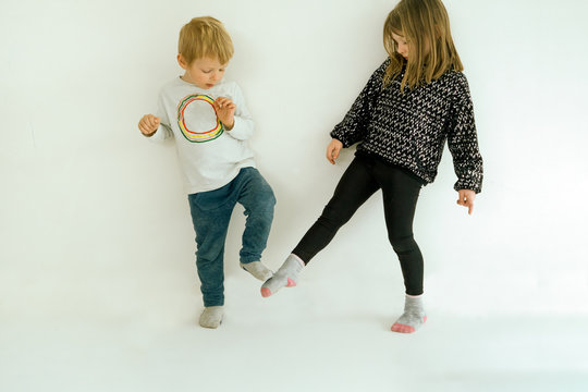 two children greetings with foot tap - new greets concept in coronavirus covid-19 pandemic outbreak time to avoid the spreading of the virus