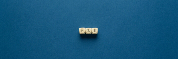 BRB abbreviation spelled on wooden dices