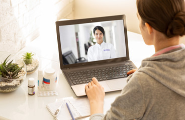 Woman sitting at home during an online consultation with her general practitioner. Medical technology, video chat with a doctor