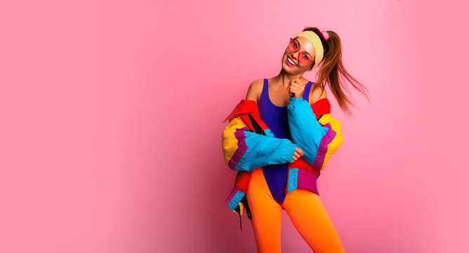 Back in time 90s 80s. Stylish girl in retro jacket and vintage aerobic body jump suit dancing, fashion trends, entertainment, heat in summer. Happy and positive. Horizontal, copy space.