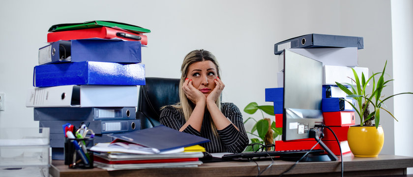 Woman sadly is sitting in her office