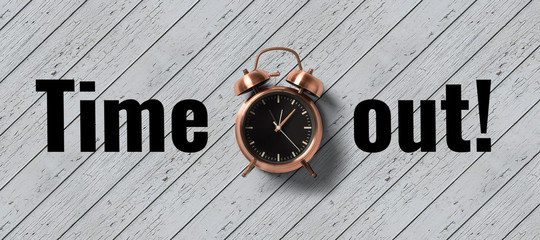 clock on wooden background with message TIME OUT