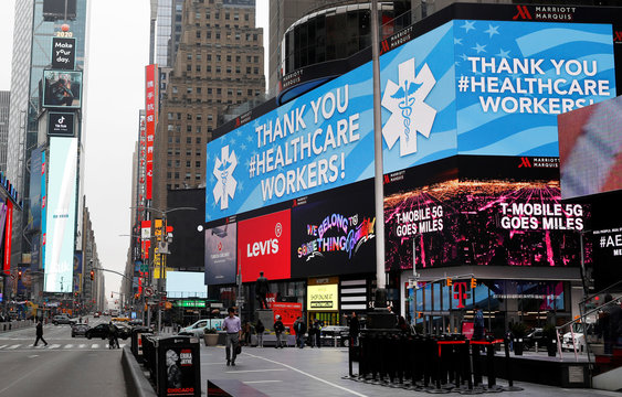 A message thanking healthcare workers during the coronavirus outbreak is seen on an electronic billboard in a nearly empty Times Square