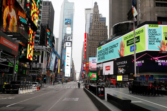 A message about protecting yourself from the coronavirus disease (COVID-19) is seen on an electronic billboard in a nearly empty Times Square