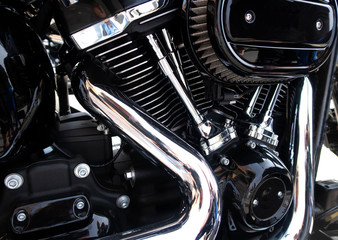 Close up view of a shiny motorcycle engine.