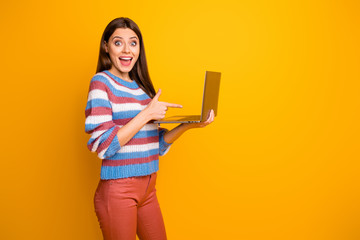 Fototapete - Portrait of her she nice attractive amazed stunned glad cheerful cheery brown-haired girl holding in hands laptop showing shop sale isolated over bright vivid shine vibrant yellow color background