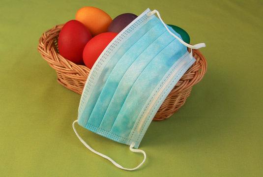 Colored eggs in basket medical mask Easter 2020