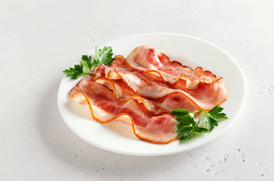 Fried bacon slices on plate