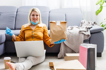 Young people at home in self-quarantine order products online delivery. Quarantined work from home....
