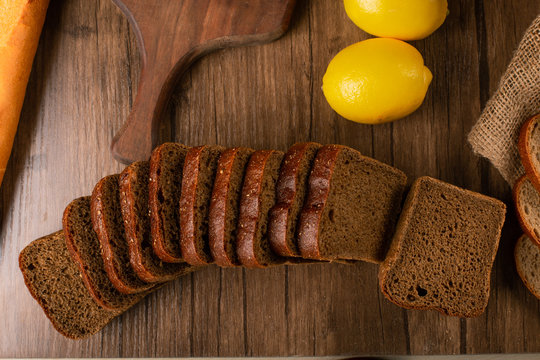 Brown bread with lemons on tablecloth