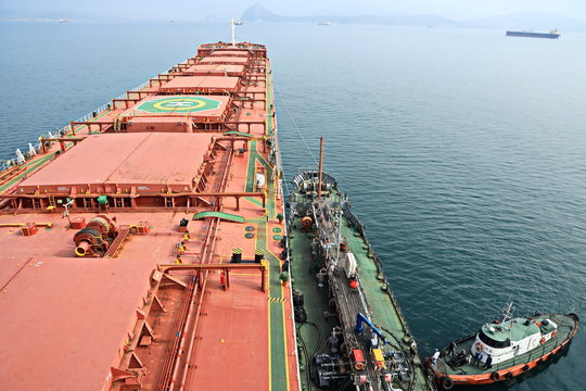 Bunkering of a ship on the open roadstead of the port of Nakhodka, Russia.