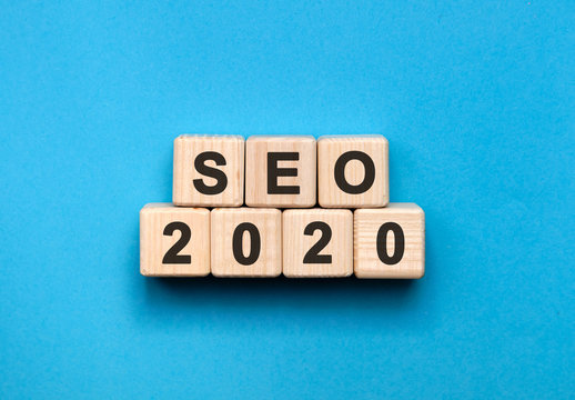 SEO 2020 text on wooden cubes on a blue background