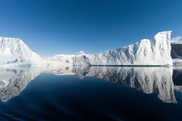 Poster Antarctica Ice berg reflected in calm water in the Errera Channel in Antarctica
