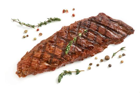 fried skirt steak on a white background