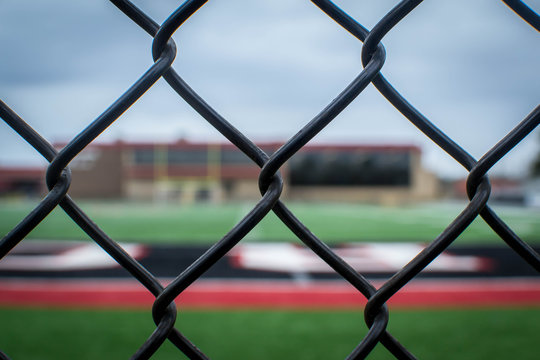 Behind the fence view of football field