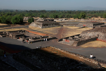 People visit the Pyramid of the Sun as they welcome the spring equinox, in the pre-hispanic city of Teotihuacan, dampened by coronavirus threat, in this picture taken from top of the pyramid of the sun, on the outskirts of Mexico City