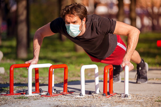 Single male on the training, street workout, with mask preventive of corona virus