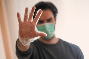 Detail of single male, he saying stop corona virus with hygienic mask and gloves