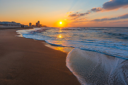 The urban skyline and North Sea beach of Ostend City (Oostende in Flemish) at sunset along the Belgian coast, West Flanders, Belgium, Europe.