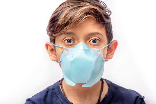 Latino boy with blue mask taking care of his health and avoiding the coronavirus pandemic