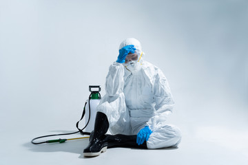 female virologist, wearing PPE. She is feeling hopeless and tired.