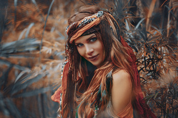 beautiful young boho gypsy style woman outdoors portrait