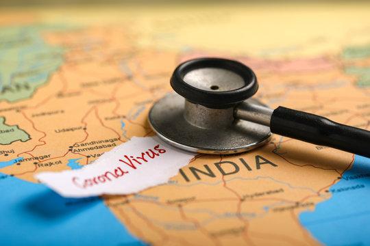 corona virus concept , Indian map marked with syringe