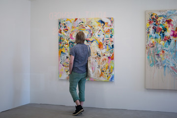 London, United Kingdom- June 2019: Boy Looking at an Abstract Painting in an Art Gallery