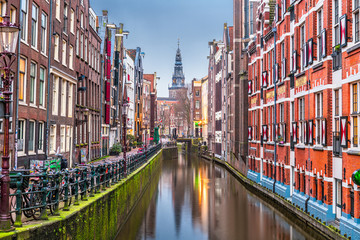 Fotomurales - Amsterdam, Netherlands canals and church tower at dawn.