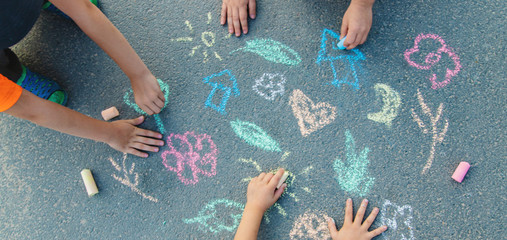 Children's drawings on the asphalt with chalk. Selective focus.