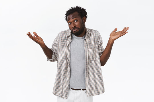 Guy have no idea, being clueless. Careless and unbothered, questioned african-american bearded man, shrugging and raising hands up confused, puzzled to answer, pulling skeptical unsure face