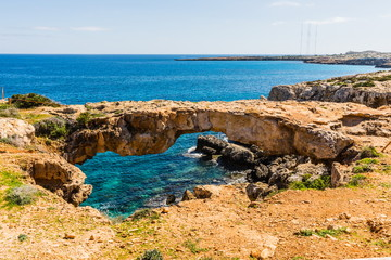 The Arch of Korakas, the most impressive natural bridge of Cyprus. Cape Greco National Park