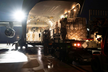 Air crew from Travis Air Force Base and the 164th Airlift Wing unload coronavirus disease (COVID-19) testing swabs in Memphis