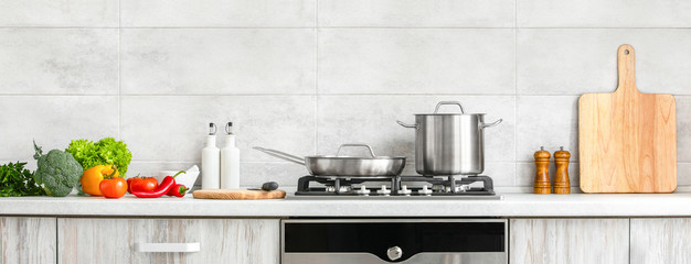Modern kitchen countertop with domestic culinary utensils on it, home healthy cooking concept banner