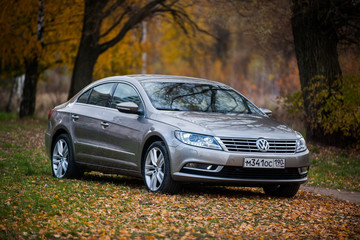 Moscow / Russia - 10 October 2013: Volkswagen Passat CC car on autumn leaves in the park