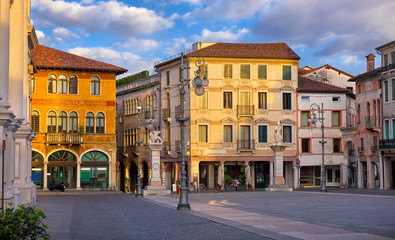 Bassano del grappa Italy. Square freedom. Landscape old town with italian architecture and street lamp. Sunrise at deserted street. Fotomurales