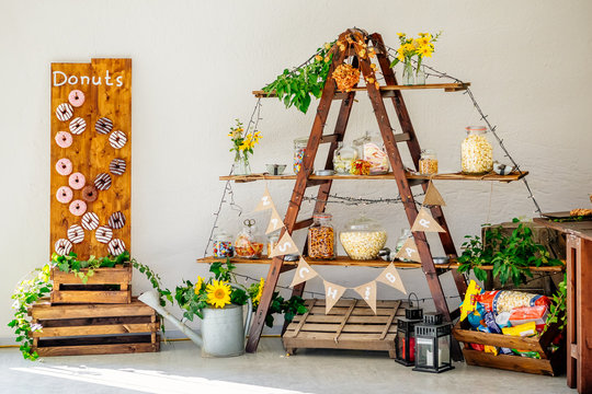 Candy Bar and salty bar with donuts and autumn thanks giving decoration at wedding