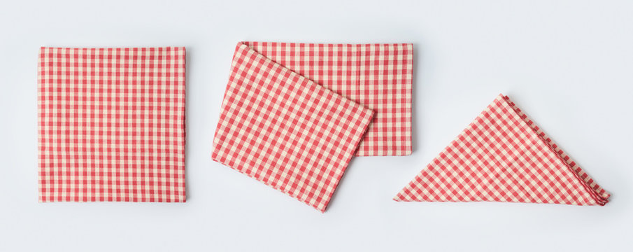 Red tablecloth or kitchen towel collection on white background. Cooking or baking mock up for design. Top view from above