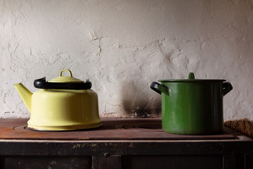 rustic kitchen stove with kettle and pan
