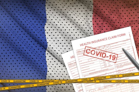 France flag and Health insurance claim form with covid-19 stamp. Coronavirus or 2019-nCov virus concept