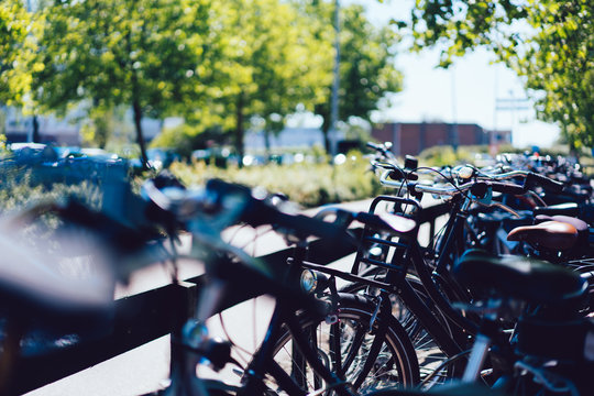 Bike transportation for free public using in metropolitan city, crowded parking with safety lockers for ecological vehicles, concept of healthy lifestyle and tourism on handlebar bicycles