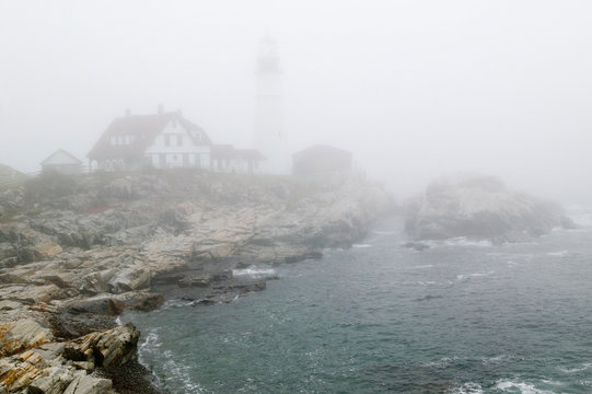 Fog shrouds the Portland Head Lighthouse in Cape Elizabeth, Maine