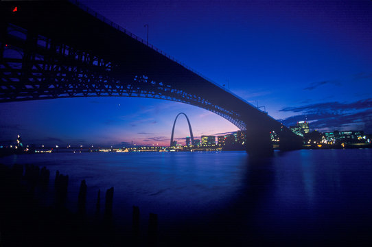 Sunset view of St. Louis, Mo skyline and Eads Bridge