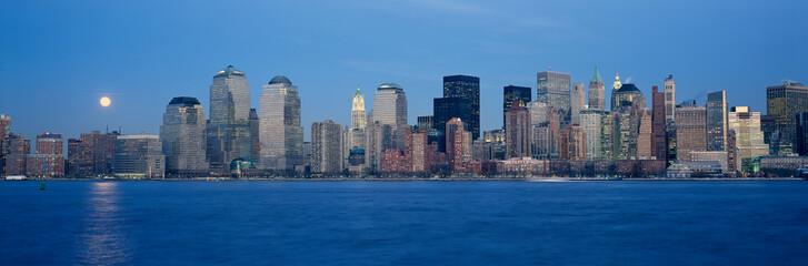 Fototapete - Panoramic view of full moon rising over lower Manhattan skyline, NY where World Trade Towers were located