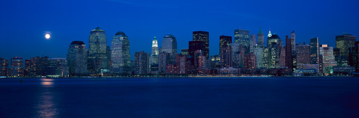 Wall Mural - Panoramic view of full moon rising over lower Manhattan skyline, NY where World Trade Towers were located