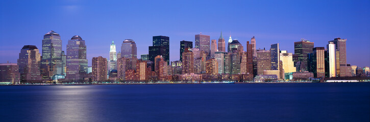 Wall Mural - Panoramic sunset view of Empire State Building and Lower Manhattan skyline, NY where World Trade Towers were located
