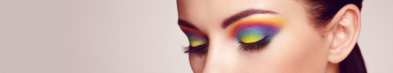 Wall Mural - Female eye with  rainbow make-up.  Long eyelashes, vivid colorful eyeshadows. Beauty. Close up, Macro