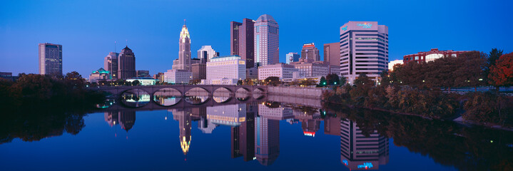 Scioto River and Columbus Ohio skyline, the capital city, at dusk with lights on