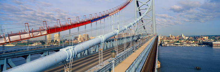 Fototapete - Panoramic view of Ben Franklin Bridge over Delaware River to Philadelphia, PA as seen from Camden NJ